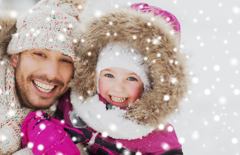 family, parenthood, fatherhood, season and people concept - happy smiling father and little girl in winter clothes outdoors